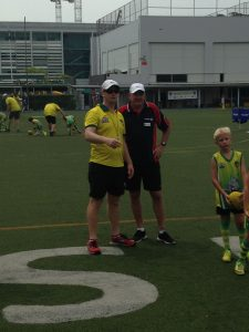AFLNT's Wally Gallio with the Singapore Sharks at the Australian International School